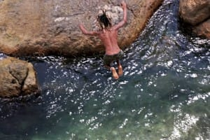 Man jumping into water hole in Galle