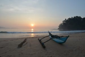 Sunset and boat on Talalla Beach